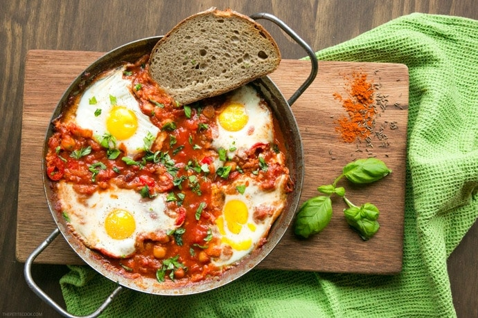 Spicy Chickpea Shakshuka is the vegetarian go-to breakfast recipe to make on weekends! This energy-packed one-pot egg recipe is also gluten-free and ready in just 30 mins. Recipe from thepetitecook.com
