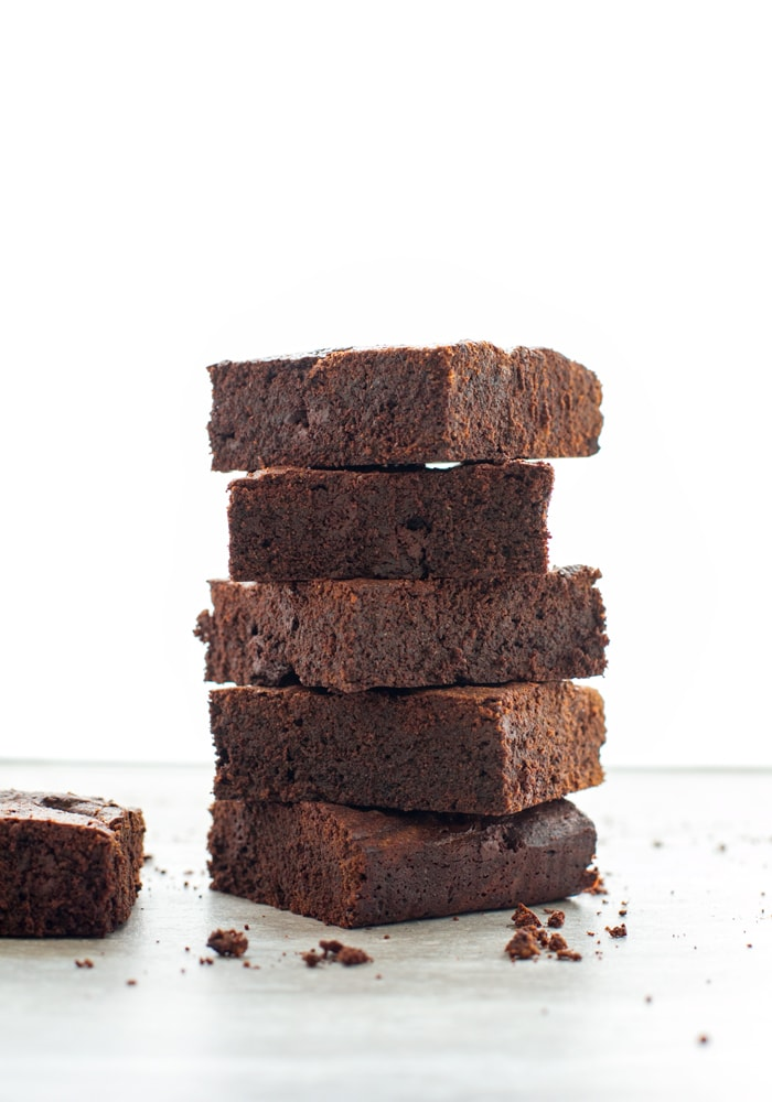 These melt-in-your-mouth chocolatey fudgy Espresso Brownies are incredibly soft and rich - Sure to satisfy your dessert cravings in a bite. Recipe by The Petite Cook